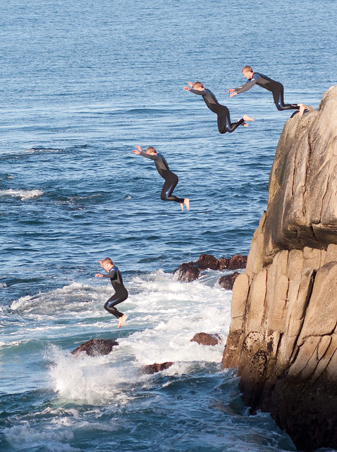 Diver jumping into the Monterey Bay