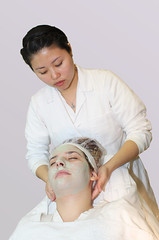 (Lori Greig) Tags: ladies college female neck relax asian student hands mask skills towel class application massage salon facial apply treatment aesthetic therapeutic cosmetology skincare esthetic cosmetologist nobackground brushon
