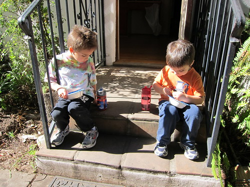 The boys have a snack on the stoop