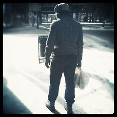 Snow man. (Morgana Wilborn) Tags: snow man black vintage square photo dallas downtown texas boots photograph photoraphy squareformat iphoneography instagramapp uploaded:by=instagram