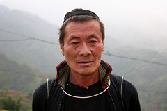 Hmong man in Sapa, Vietnam (sensaos) Tags: travel portrait people man 2004 face cat costume asia traditional north tribal jewellery vietnam viet tribe ethnic catcat sapa hmong nam indigenous hilltribe azie azi tarditional hmon sensaos