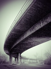 Under the bridge. (Sascha Unger) Tags: street bridge light urban blackandwhite bw art silhouette architecture germany licht traffic angle strasse perspective autobahn stadt sascha architektur sw curve brcke dsseldorf rhine rhein verkehr rheinland perspektive beton iphone spica kurve a52 schwarzweis mrsenbroich mrsenbroicherei sascha2010 saschaunger infinicam nrdlicherzubringer