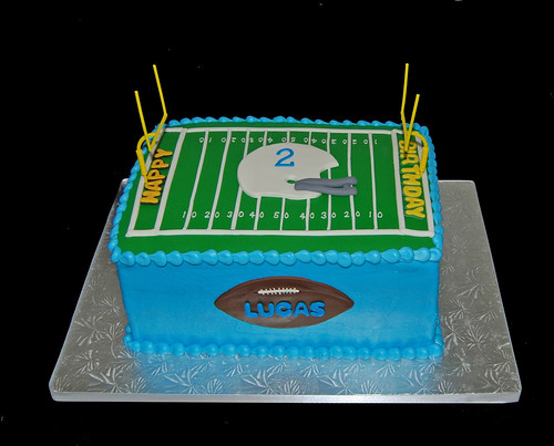 Football Themed Cakes http://simplysweetsaz.blogspot.com/2011/02/2nd-birthday-cake-for-big-game-football.html