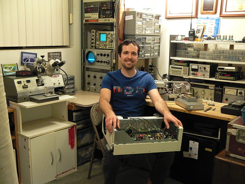 Me in my electronics room.  I'm holding the beginnings of a cryogenic receiver project.