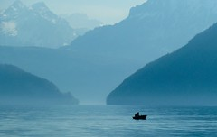 Lonely boat (Channed) Tags: blue mountain lake mountains switzerland see boat meer luzern lucerne flickrblog vierwaldstttersee zwitserland myswitzerland natureplus flickrchallengegroup flickrchallengewinner luzernersee chantalnederstigt
