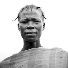 Majangir woman in Fide village - Ethiopia (Eric Lafforgue) Tags: africa people woman colour look gabi horizontal female outside outdoors person femme culture tribal tribes shawl tradition ethiopia tribe ethnic personne humanbeing tribo regard contemplation afrique ethnology tribu dehors eastafrica carre abyssinia ethiopie exterieur fide lookingatcamera waistup squarepicture 4786 abyssinie vueexterieure coloredpicture ethnie gambela photocouleur gambella afriquedelest alataille etrehumain regardantlobjectif imagecarree majangir gambellaprovince provincedegambella regiondegambela gambelaarea colouredpicture cadragealataille ethiopianscarf villagedefide villageoffide