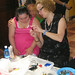 American artist working with Down Syndrome students on jewelry making techniques.