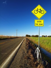 sharing is caring! (al-absi) Tags: california road bike bicycle sign woodland country olympus cycle davis share ucd winters   1442  e620