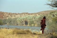 Epupa (ronniedankelman) Tags: africa travel woman baby water canon landscape waterfall border afrika tribe namibia stam landschap kaokoveld himba afrique reizen grens epupa waterval namibie kunene ovahimba landofthebrave republicofnamibia