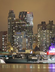 Behind the Intrepid ( estatik ) Tags: new york city nyc windows light panorama ny reflection tower vertical skyline museum night triangles skyscraper river dark hearts long exposure aircraft leed jersey intrepid hudson carrier verticle
