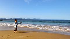 barefoot (raphaelmelnick) Tags: ocean blue sea beach canon children fun happy seaside sand play joy childrenplaying