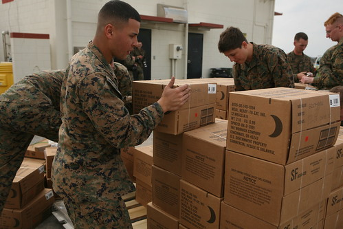 Marines prepare supplies for relief efforts in Japan following eathquake.