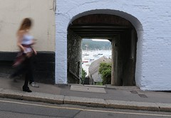 Harbour footfall (lynn.pascoe) Tags: pavement movement tunnel town archway paleblue