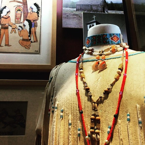 Okanagan #FirstNation woman's tunic and artworks in exhibition at Nk'Mip Desert Cultural Centre. #Osoyoos is on the #Canada - #USA border in semi desert. It's been home to First Nation people for thousands of years. The Nk'Mip Centre is a must-see for vis