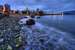 The Blue Hour Rocks! (Brandon Godfrey) Tags: city longexposure urban canada beach water skyline vancouver reflections landscape outdoors photography evening coast movement twilight scenery rocks downtown cityscape bc metro britishcolumbia smooth scenic citylife rocky wideangle canadian pacificnorthwest burrardinlet metropolis stanleypark bluehour canadaplace hdr coalharbour silky harbourcentre electricblue thebluehour lowermainland northshoremountains portofvancouver scotiatower crabpark portsidepark touristdestination vancouverpanpacific