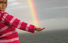 Holding onto a promise ([rach.imo]) Tags: ocean pink water girl face hair rainbow holding hands hand stripes horizon perspective jacket catching jumper promise stripy hairinface bestofblinkwinners blinksuperstars