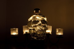 La Calavera (Neilwill) Tags: lighting glass dark skull bottle candles crystal creepy liquid crystalskull crystalheadvodka illunated