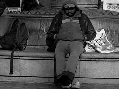 Cabezada al Sol/A snooze in the sun (Joe Lomas) Tags: poverty madrid street leica urban blackandwhite bw españa black byn blancoynegro fotosencadenadas bench calle spain candid negro poor banco bn beggar reality streetphoto urbano pobre plazamayor indigente mendigo pobreza indigencia urbanphoto realidad callejero limosna robados realphoto necesitado pordiosero limosnero fotourbana fotoenlacalle fotoreal photostakenwithaleica