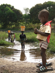 (StineHein) Tags: boy water river big shoes little sierraleone getting
