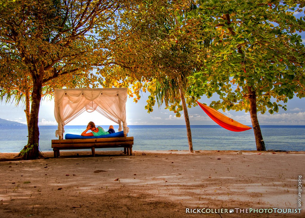 A beach cabana offers comfortable lounging with a cool breeze and sea view