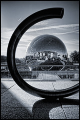 France - Paris - Parc de la Villette - La Geode 13 mono (Darrell Godliman) Tags: travel blackandwhite bw sculpture copyright paris france reflection building tourism monochrome architecture triangles reflections mono mirror nikon frankreich triangle stainlesssteel shiny europe postmodern circles curves eu curvy structure nb reflected sphere toned geode francia orbit tinted modernarchitecture sciencemuseum circular lavillette allrightsreserved spherical parcdelavillette triangular rpubliquefranaise contemporaryarchitecture travelphotography omnimax citdessciencesetdelindustrie citedessciencesetdelindustrie instantfave bernardtschumi lageode adrienfainsilber omot travelphotographer fainsilber flickrelite dgphotos darrellgodliman wwwdgphotoscouk peterrice d300s sigmaantigravitationnel manolismaridakis nikond300s dgphotosparis franceparisparcdelavillettelageode13monodsc4649