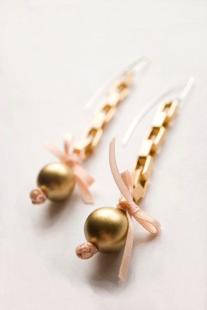 gold with pink bows