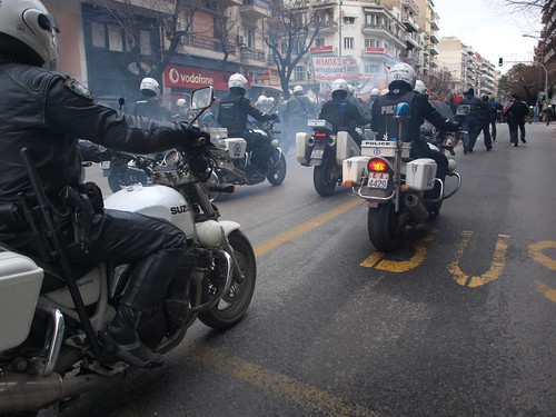Greek police motorcycle units used to chase and intimidate marchers in anti-government demonstration - Thessaloniki, Greece