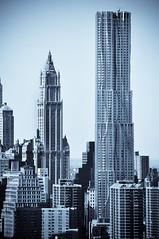 Side by Side (street level) Tags: city nyc newyorkcity travel urban newyork building skyline architecture skyscraper nikon downtown skyscrapers manhattan gehry gothamist woolworthbuilding d90 beekmantower nikond90club 8sprucest