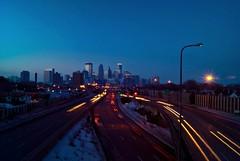 Star of Minneapolis (Doug Wallick) Tags: street city bridge winter light urban snow minnesota skyline star midwest exposure downtown minneapolis overpass pedestrian pole manual streaks picnik lightroom a230 interstate35