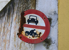 Not Evil Knievel's finest moment (steverichard) Tags: auto street old city travel building portugal car sign canon outside photo traffic image decay rusty pedestrian motorbike lane round access bent rider twisted narrow circular evora 2010 nocars novehicles nomotorbikes img7656 ebora steverichard srichardimages