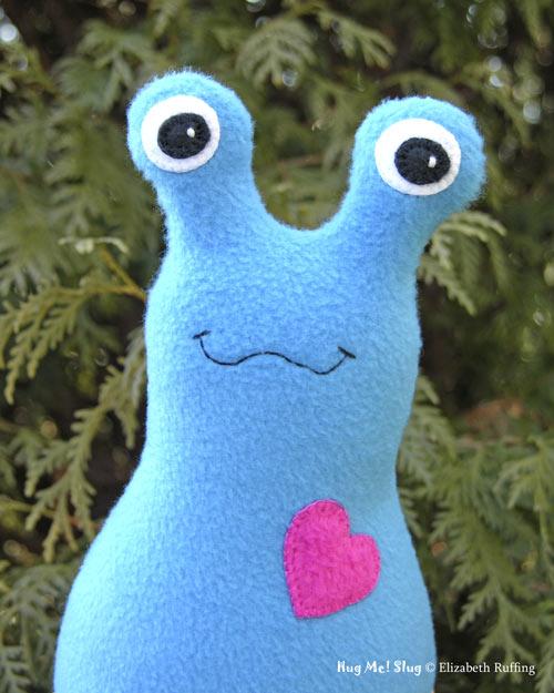 Turquoise-blue Fleece Hug Me Slug by Elizabeth Ruffing