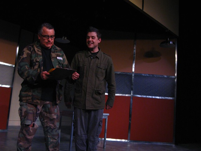 Pvt. Whilikers (Colin Willkie) delivers a telegram.