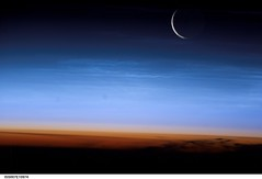 Moonset Over Earth (NASA, International Space Station, 07/27/03) (NASA's Marshall Space Flight Center) Tags: moon clouds earth nasa 1001nights limb moonset tropopause noctilucent stationscience crewearthobservation stationresearch trposphere