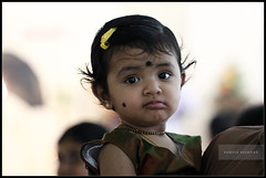 Varsha!... (ramesh.rasaiyan) Tags: portrait baby cute kids lights kid trichy varsha weddingfunction canoneosrebelt1i canon100mmf28lisusm rameshrasaiyan