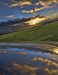 reflections on a car (Wim Koopman) Tags: sunset sky holland netherlands dutch car clouds reflections photography mirror photo stock nederland meadow double hood grassland stockphoto stockphotography kubaard wpk