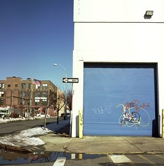 One Way (12th St David) Tags: door blue white snow newyork reflection brick 120 6x6 film wall brooklyn mediumformat square graffiti factory garage americanflag slide gowanus e6 corrugated garagedoor fujiastia100 rolleicord mittelformat rolleicordv formatomedio xenar75mmf35