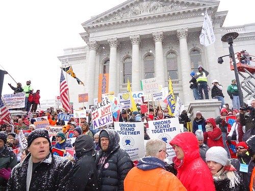 Protestors demonstrate in the snow for We Are Wisconsin