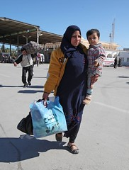 Emergency situation in Tunisia (UNHCR) Tags: africa woman baby support child tunisia refugees border egypt hijab relief help aid emergency libya protection assistance unhcr northernafrica humanitarianaid unrefugeeagency humanitariancrise