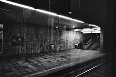 Subway (andersdenkend) Tags: city urban blackandwhite bw lines stairs analog train reflections underground subway vanishingpoint metro grain steps perspective tracks tram zug wideangle tiles rails analogue marble grainy escalators korn untergrund reflexionen artificiallight marmor weitwinkel nikkormatftn fluchtpunkt ilfordxp2super400 nikkor24mmf28 strasenbahn