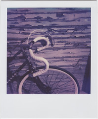 (Design.Her) Tags: film bike bicycle polaroid sx70 purple instant peugeot instamatic onestep px70 designher theimpossibleproject colorshadepush