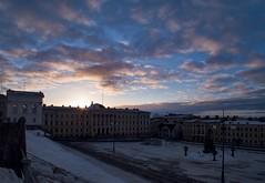 Sun is coming up (BigWhitePelican) Tags: morning clouds sunrise finland march helsinki senaatintori 2011 fujifilmfinepixhs10