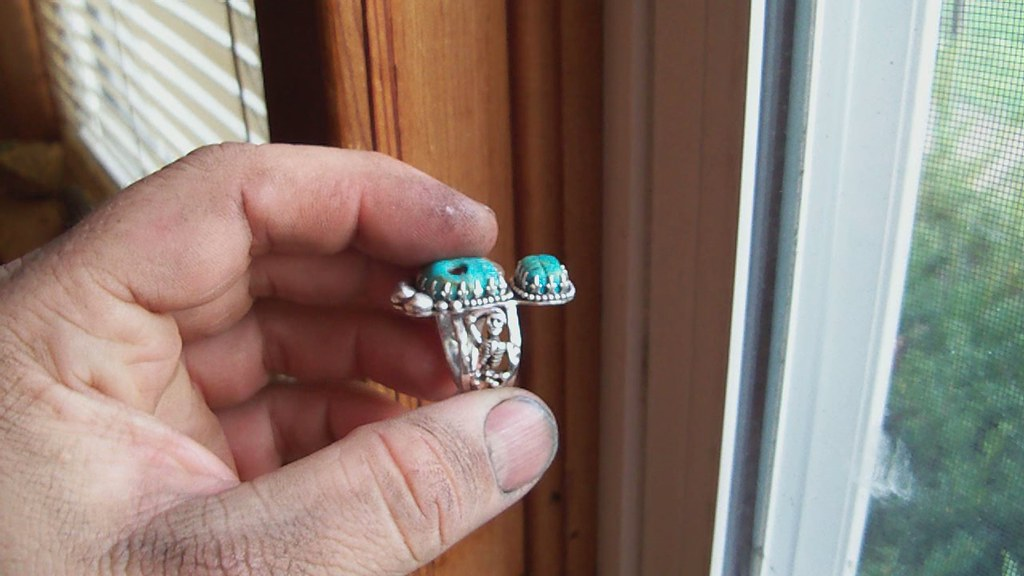 Mictecacihuatl walking with the dead turquoise and sterling silver ring .
