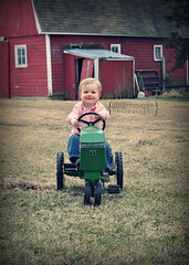 little farmer (jinjur71) Tags: boy portrait baby tractor green barn 50mm spring nikon child outdoor farm country naturallight d90 johndere gingersnapps