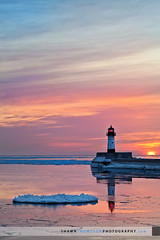 North Pier Lighthouse Canal Park (Shawn Thompson - Lake Superior Photographer) Tags: lighthouse ice water sunrise beacon duluth lakesuperior canalpark northpierlighthouse llmsmnduluth