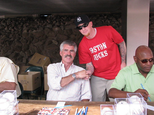 Tom donated to charity to get his photo taken with Bill Buckner while wearing his 'Boston Sucks' shirt