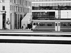 Oslo Central Station (Oslo S) with Barcode Buildings (mono) - Day 136/365 (trondjs) Tags: people urban blackandwhite bw man monochrome oneaday lines oslo norway architecture modern train canon buildings photography mono norge photo spring raw geometry photoaday barcode oslos centralstation photog pictureaday g11 mvrdv 2011 project365 oslosentralstasjon sentralstasjonen trondjs project365136 railwaystastion project36516may11 project365051611