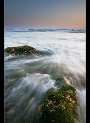 some rocks in the pacific ocean (Matt Kawashima) Tags: ocean california sunset sky water rock way out coast moss cool long exposure waves pacific or central wave ham boring coastal cal crap coastline whatever lame algae bro standard distance poly epic anyway