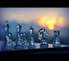 Logic will get you from A to B. Imagination will take you everywhere. (Violet Kashi) Tags: sunset sun game closeup photography dof board chess imagination transparent logic  macromondays