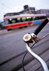 Poppy Bell and BS (Georgie_grrl) Tags: toronto ontario flower bike bicycle downtown bell bs ttc transit poppy pentaxk1000 streetcar rikenon12828mm akablurryshit