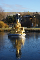 Kagyu Samye Ling Tibetan Buddhist Centre (cheesemonster) Tags: reflection water statue religious golden scotland frozen still cobra sitting peace lotus alba buddhist centre buddhism retreat harmony tibetan iced meditation icy buddah budist budda samye buddist ling caledonia budhist schottland dumfriesgalloway ecosse kagyu dumfriesandgalloway lotusposition eskdalemuir kagyusamyeling tibetanbuddhistcentre ecosia retreet moorofthevalleyoftheriveresk